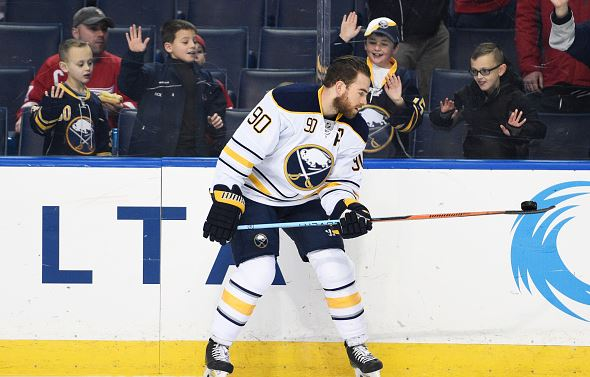Ryan O'Reilly #90 of the Buffalo Sabres picks up a puck with his stick during warmups during the game against the Detroit Red Wings on Friday, January 22, 2016 at the First Niagara Center in Buffalo, New York. (Photo by Tom Brenner/ Getty Images