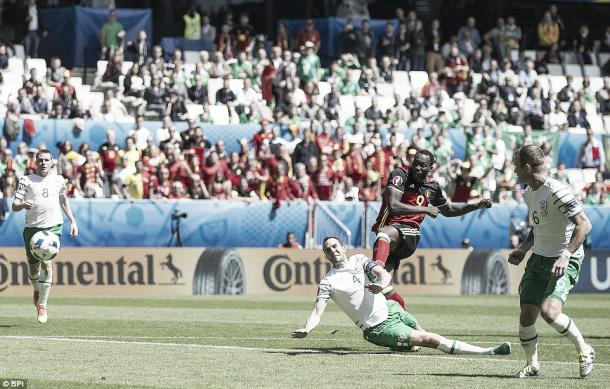 Above: John O'Shea sliding in on Romelu Lukaku in Ireland's 3-0 win over Belgium | Photo: BPI