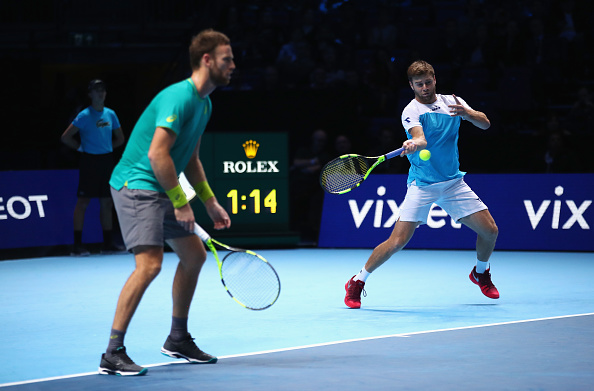 Ryan Harrison fires a forehand with Michael Venus ready to react (Photo: Clive Brunskill/Getty Images)