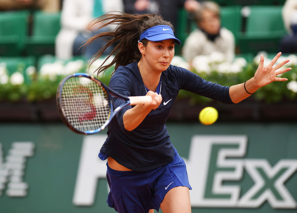 Oceane Dodin returns a serve at the French Open in Paris/Getty Images