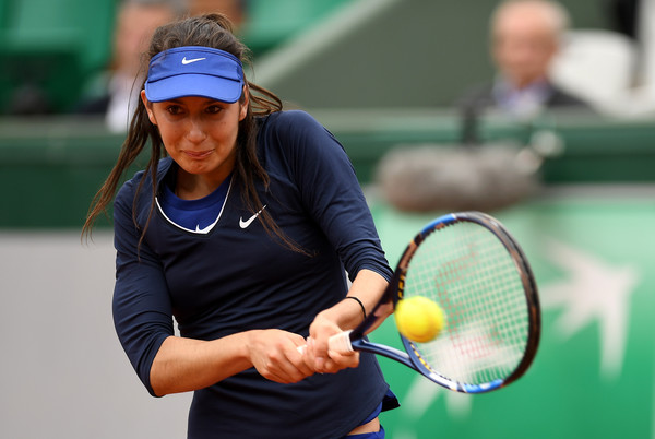 Océane Dodin hits a backhand during her first round match against Ana Ivanovic at the 2016 French Open. | Photo: Dennis Grombkowski/Getty Images Europe