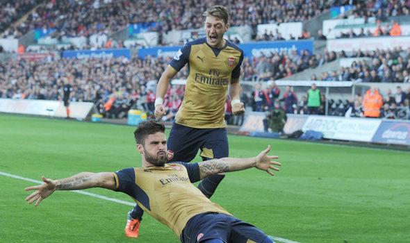 Mesut Ozil and Oliver Giroud. Source: express.co.uk