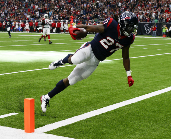D'Onta Foreman #27 of the Houston Texans runs 34 yards for a touchdown in the fourth quarter against the Arizona Cardinals. |Source: Bob Levey/Getty Images North America|