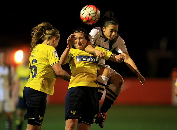 Lauren Haynes battles for an aerial ball with Emily Heaslip (Photo credit: Ben Hoskins)