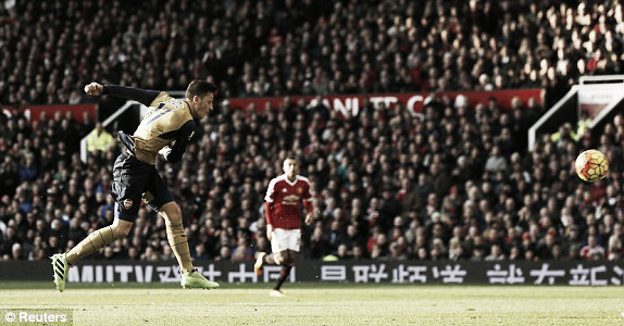 Above: Mesut Ozil scores in Manchester United's 3-2 win over Arsenal  image source: Reuters