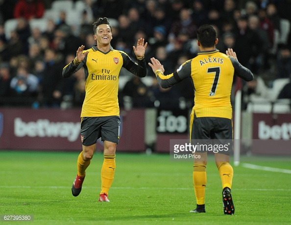 Ozil and Sanchez celebrating Arsenal's opening goal in their 5-1 win away at West Ham in December. (Image By Getty Images/David Price)