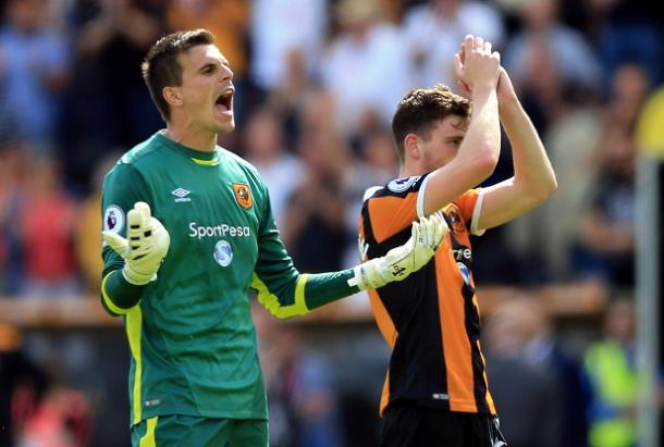 Jakupovic and Robertson celebrate the victory (Photo: Getty Images)