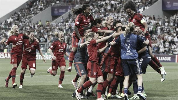 Bouhaddi and Kumagai are mobbed by teammates after respectively edging their side to victory. (Photo: UEFA)