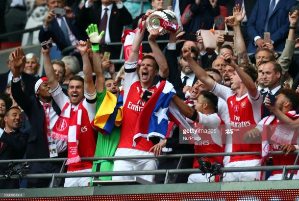 Arsenal's Per Mertesacker with Trophy during The Emirates FA Cup - Final between Arsenal against Chelsea at Wembley Stadium on May 27 2017 , England (Photo by Kieran Galvin/NurPhoto via Getty Images)