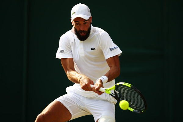 Paire crushes one of his brilliant backhands during the round two win. Photo: Clive Brunskill/Getty Images