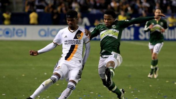 LA's Bradford Jamieson IV and Portland's Alvas Powell battling for control of the ball. Photo provided by Sean M. Huffey-AFP