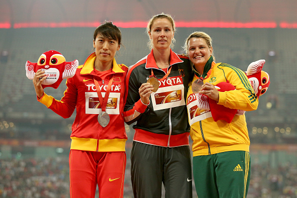 Huihui Liu, Katherine Mollitor and Sunette Viljeon pose with their medals at the World Championships last year (Getty/Patrick Smith)