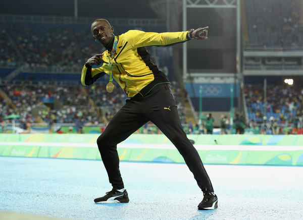 Usain Bolt celebrates another Olympic gold medal win in Rio de Janiero. Photo Credit: Patrick Smith of Getty South America