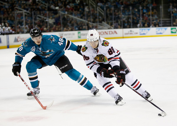 Patrick Kane #88 of the Chicago Blackhawks tries to skate away from Tomas Hertl #48 of the San Jose Sharks at SAP Center on November 25, 2015 in San Jose, California. (Nov. 24, 2015 - Source: Ezra Shaw/Getty Images North America)