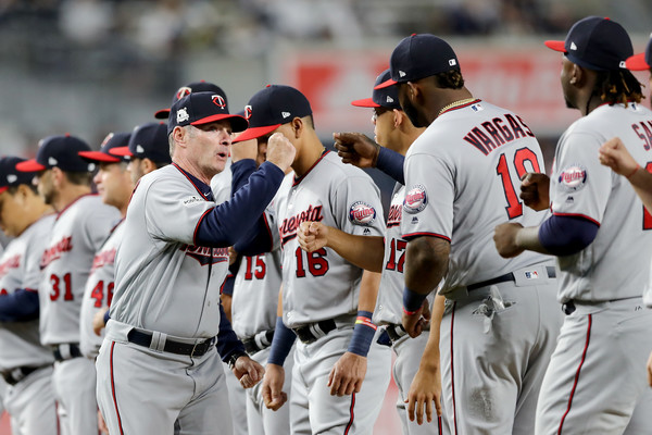 Paul Molitor #4 of the Minnesota Twins high fives his team prior to the American League Wild Card Game against the New York Yankees.  Source: Elsa/Getty Images North America 