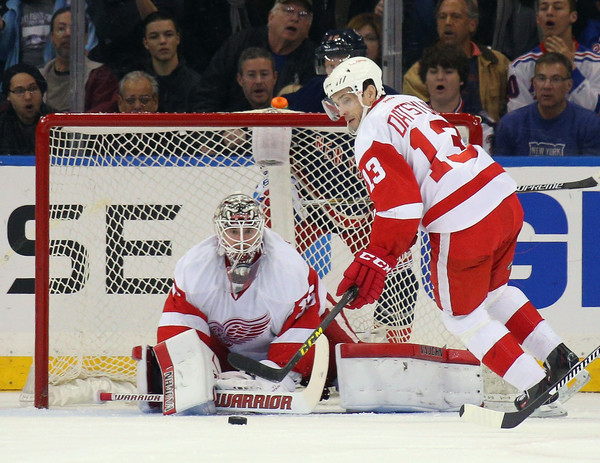 Jimmy Howard #35 and Pavel Datsyuk #13 of the Detroit Red Wings defend the net against the New York Rangers during the first period at Madison Square Garden on April 9, 2016 in New York City. (April 8, 2016 - Source: Bruce Bennett/Getty Images North America)