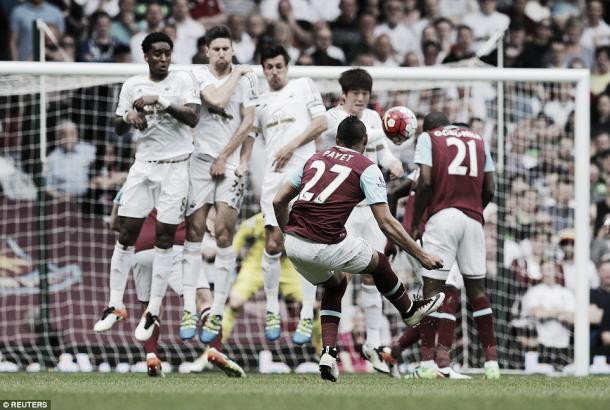 Above: Dimitri Payet curls a free-kick in West Ham' 4-1 defeat to Swansea | Photo: Reuters