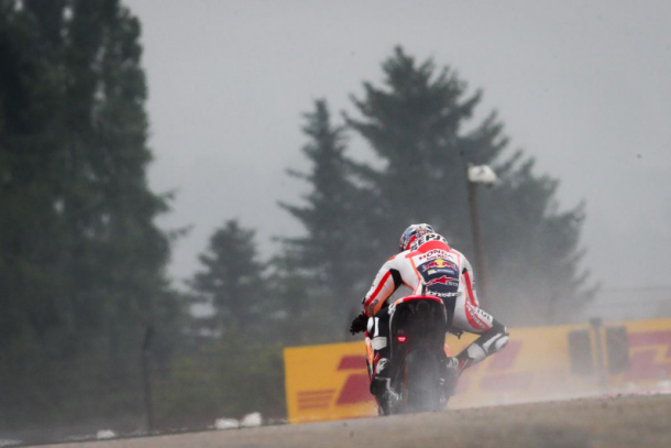 Dani Pedrosa kicking up spray at Sachsenring - www.motogp.com