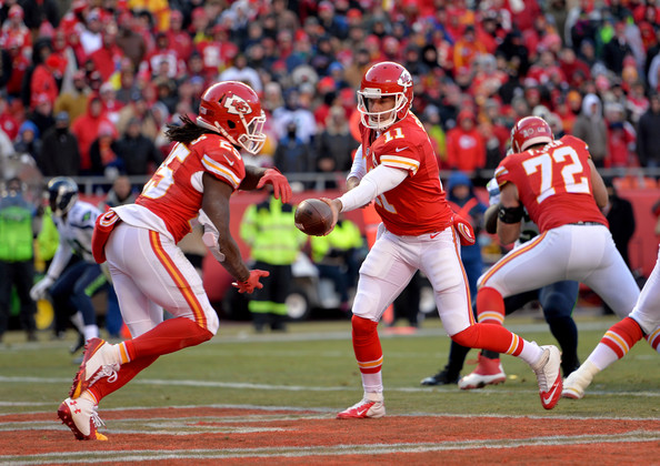 Jamaal Charles taking a handoff from Alex Smith in the backfield. Photo Credit: Peter Aiken of Getty
