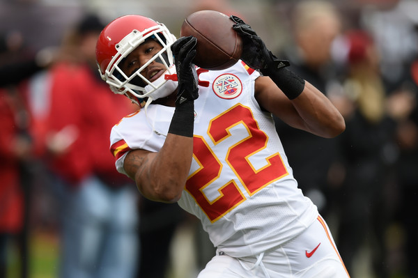 Marcus Peters warms up before his game against the Oakland Raiders