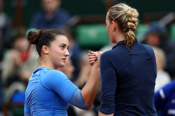 Petra Kvitova and Danka Kovinic shake hands after the match/Getty Images/Julian Finney