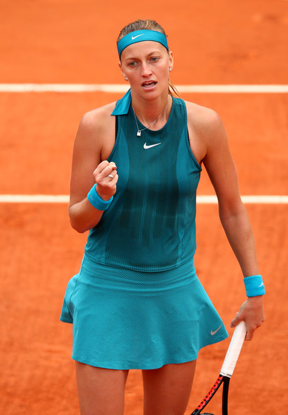 Petra Kvitova celebrates winning a point | Photo: Clive Brunskill/Getty Images Europe
