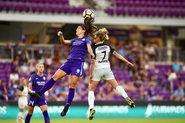 Alex Morgan (left) battles with McCall Zerboni (7) in the air during the 4-3 Orlando loss on Wednesday. | Photo: Andy Mead - isiphotos.com