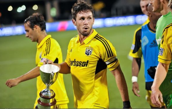 Danny O'Rourke #5 of the Columbus Crew walks off the field with the Lamar Hunt Pioneer Cup after Columbus defeated FC Dallas 2-1 on May 12, 2012 at Crew Stadium in Columbus, Ohio. (Photo by Jamie Sabau/Getty Images