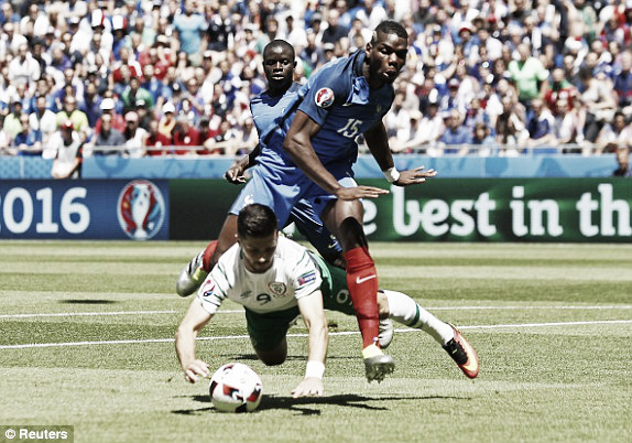 Above: Paul Pogba been bowled over Shane Long in France's 2-1 win over Ireland | Photo: Reuters