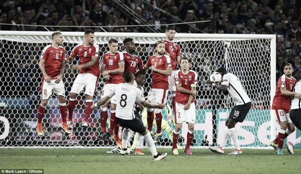Above: Switzerland defending a  Dimitri Payet free-kick in their 0-0 draw with France | Photo: Matt