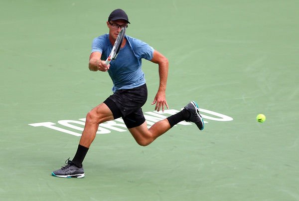 Peter Polansky hits a forehand during his second-round loss in Toronto. Photo: Getty Images