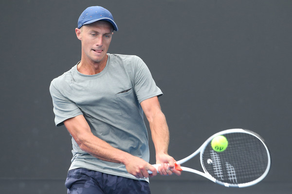 Peter Polansky hits a backhand during his first round match at the Australian Open. Photo: Pat Scala/Getty Images