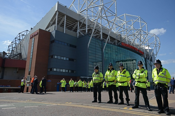 Police line a 100m radius of Old Trafford | Photo: Oli Scarff/AFP