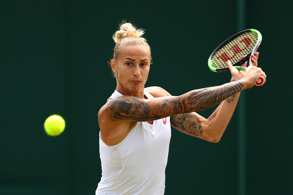 Polona Hercog hits a sliced backhand shot during the match | Photo: Michael Steele/Getty Images Europe