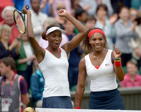 Venus and Serena Williams celebrate their third doubles gold medal in London (Image: Popperfoto)