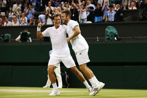Pospisil (left) and Sock celebrate their Wimbledon victory. Photo: Jan Kruger/Getty Images
