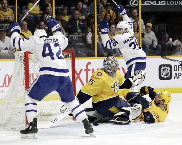 The Toronto Maple Leafs gang up on Nashville goalie Pekka Rinne. (AP Photo/Mark Humphrey)