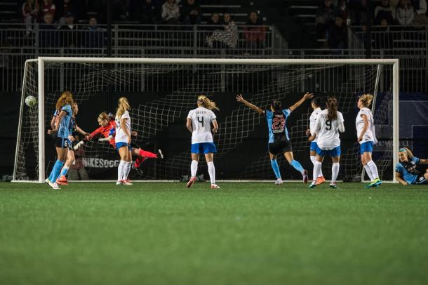 Christine Press (23, center) celebrates as her goal goes into the net against the Boston Breakers | Chicago Red Stars Twitter - @chicagoredstars