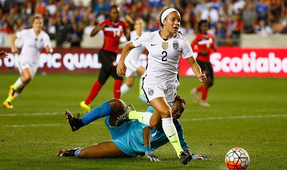 Mallory Pugh #2 of the United States battles for the ball with keeper Kimika Forbes #1 of Trinidad and Tobago during their Semifinal of the 2016 CONCACAF Women's Olympic Qualifying at BBVA Compass Stadium on February 19, 2016 in Houston, Texas. (Photo by Scott Halleran/Getty Images