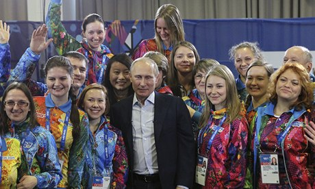 Vladimir Putin with volunteers during the 2014 Winter Olympics in Sochi. Photo: Sasha Mordovets/Getty