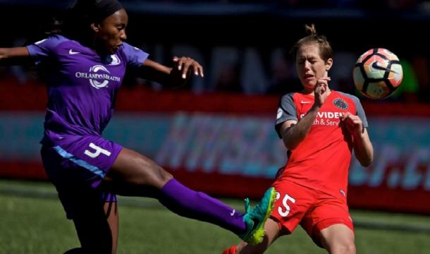 Jamia Fields battling with Meghan Klingenberg during a 2017 NWSL regular season game. | Photo: Craig Mitchelldyer