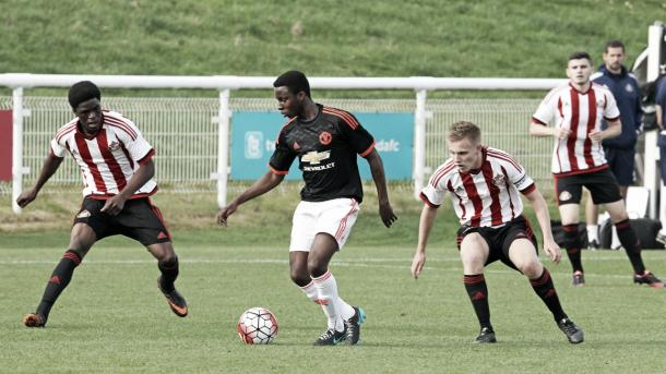 Sunderland's Dan Pybus and Josh Maja in action for the U18's against Manchester United | Photo: manutd.com