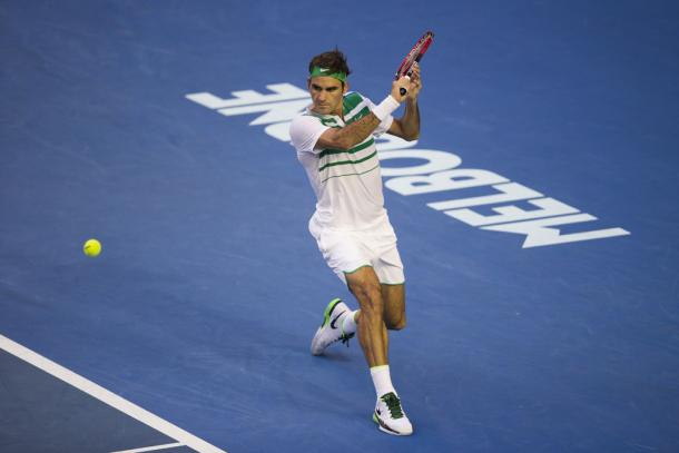 Federer slices a backhand return at the 2016 Australian Open. Credit: REX/Shutterstock