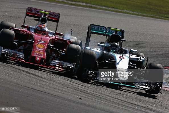 Nico Rosberg clouts Kimi Raikkonen. | Photo: Getty Images