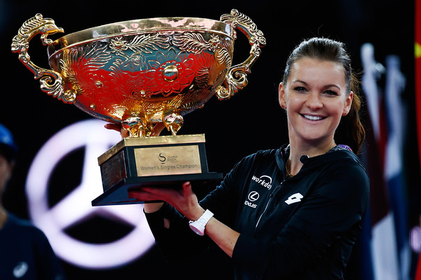 Radwanska hoists her trophy in Beijing. Photo: Etienne Oliveau/Getty Images