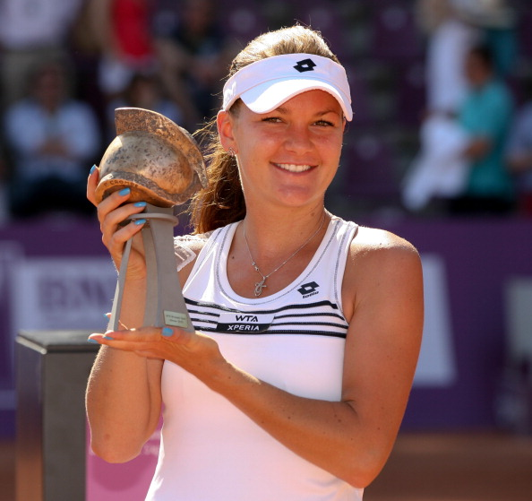 Radwanska holds the trophy after winning her most recent clay court title, in Brussels in 2012. Photo: Virginie Lefour/AFP/Getty Images
