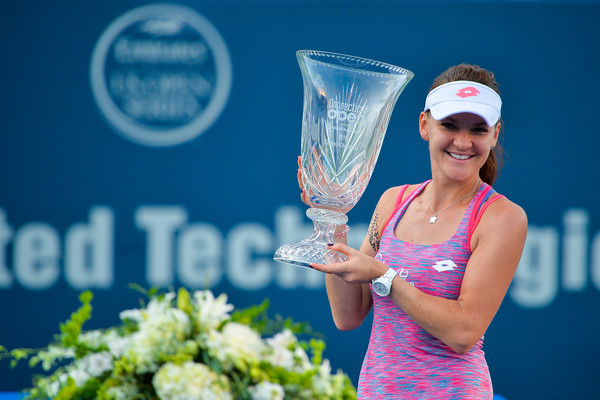 Radwanska poses with her New Haven trophy in August. Photo: Alex Goodlett/Getty Images