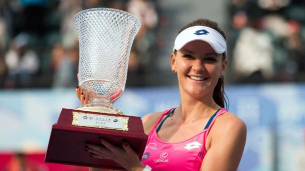 Radwanska hoists her trophy in Shenzhen in January. Photo: AFP