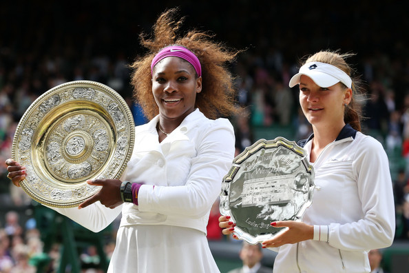 Radwanska (right) poses with her trophy along with Serena Williams after the 2012 final. Photo: Julian Finney/Getty Images