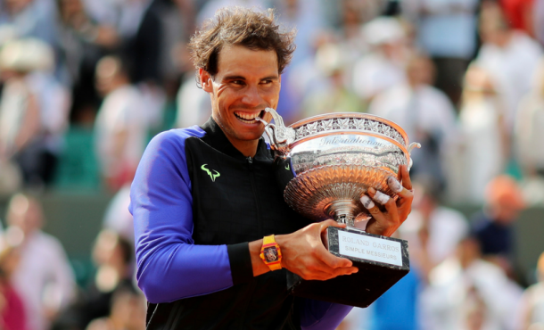 Rafael Nadal won five majors in the inter-Federer period, including this historic 10th French Open title. Photo: Adam Pretty/Getty Images
